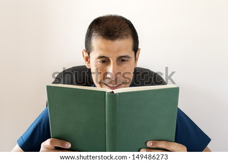 smiling man reading a book with a white background