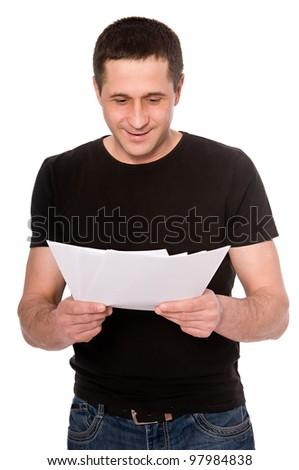 smiling man reading documents isolated on white background - stock photo