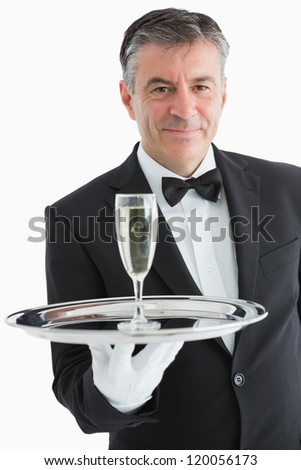 Smiling man serving champagne on silver tray