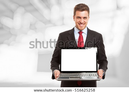 Smiling man showing a notebook