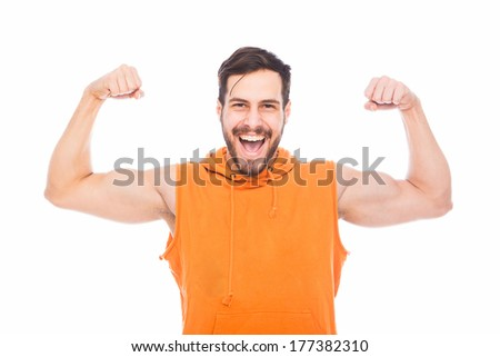 smiling man standing and showing his muscles with tailor tape measure on white background - stock photo