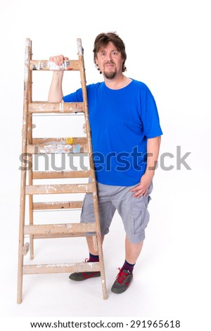 Smiling man standing next to a ladder isolated on a white background