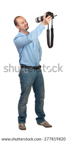 smiling man take selfie with reflex camera and big lens