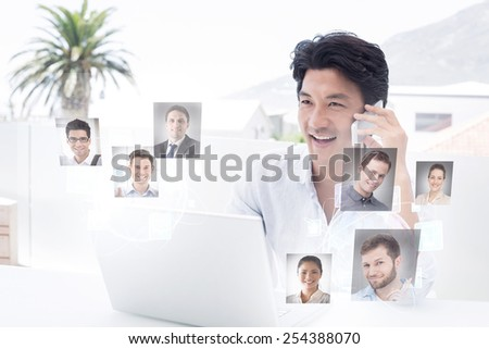 Smiling man using his laptop and talking on phone against profile pictures