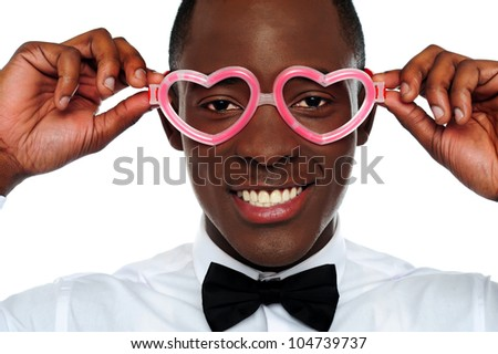Smiling man wearing heart shaped eye-wear. Love and funny concept