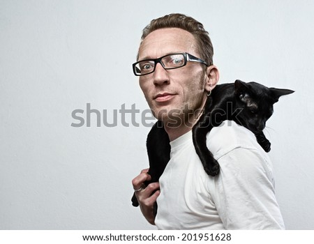 smiling man with a sad cat on his shoulders. animal care concept.  - stock photo