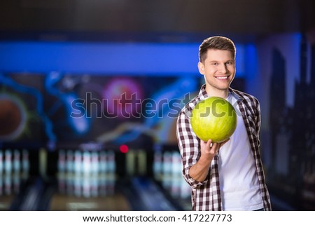 Smiling man with bowling ball