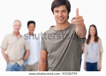 Smiling man with friends behind him giving approval against a white background