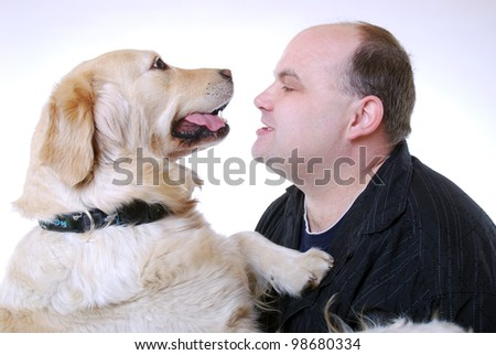 smiling man with his golden retriever - stock photo