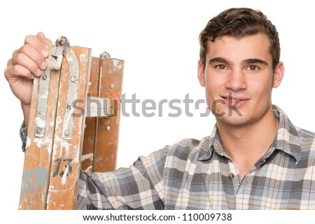 Smiling man with ladder in front of white background - stock photo