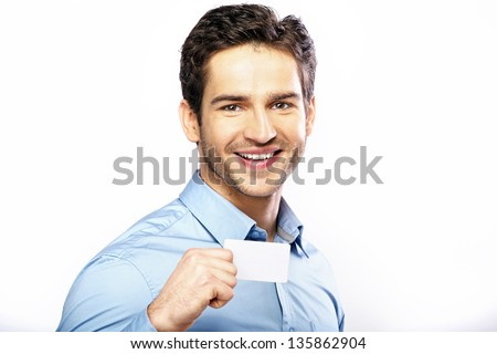 Smiling man with small card - stock photo