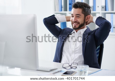 Smiling manager happy with results of his work - stock photo