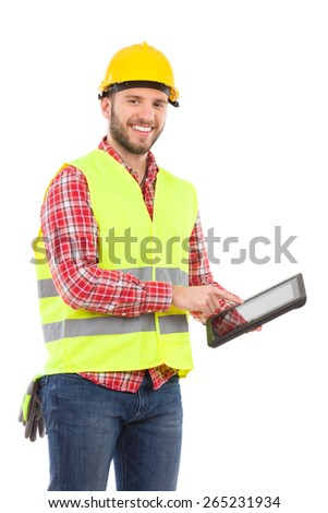 Smiling manual worker in yellow helmet and lime waistcoat holding a digital tablet. Three quarter length studio shot isolated on white. - stock photo