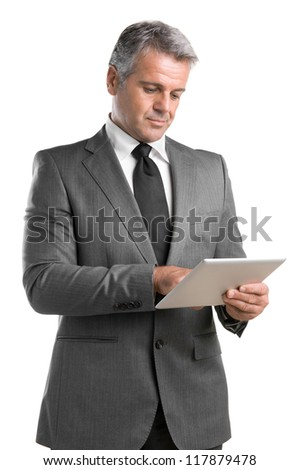 Smiling mature businessman working on digital tablet isolated on white background - stock photo