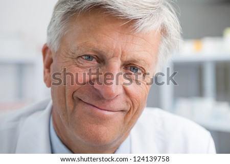 Smiling mature doctor - stock photo
