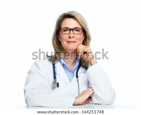 Smiling mature doctor woman. Isolated over white background. - stock photo
