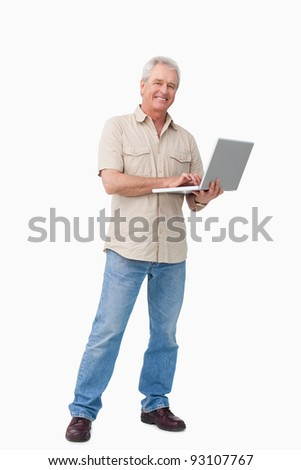 Smiling mature male with his laptop against a white background - stock photo