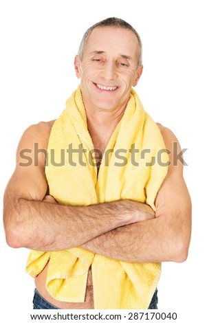 Smiling mature man with a towel around neck. - stock photo