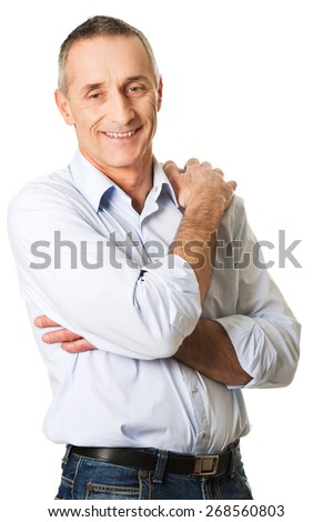 Smiling mature man with folded arms