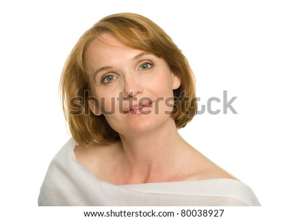 Smiling mature woman in white. - stock photo