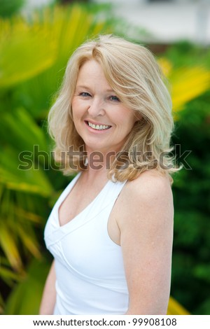 smiling mature woman natural beauty portrait outside - stock photo
