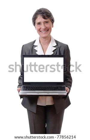 Smiling mature woman presenting laptop with empty screen isolated on white background