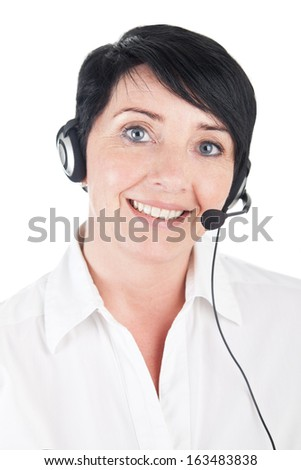 Smiling mature woman with headset - stock photo