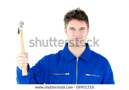 Smiling mechanic holding a hammer looking at the camera against white background