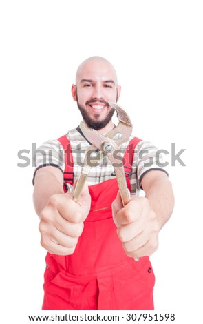 Smiling mechanic holding an adjustable wrench isolated on white studio background - stock photo
