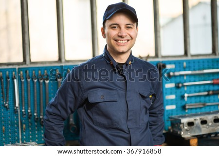Smiling mechanic portrait - stock photo