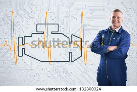 Smiling mechanic standing proudly in front of engine background - stock photo