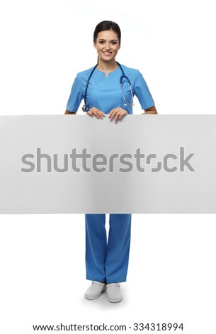 Smiling medical doctor holding a screen isolated on white - stock photo
