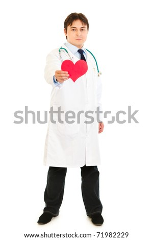 Smiling medical doctor holding paper heart in hand  isolated on white