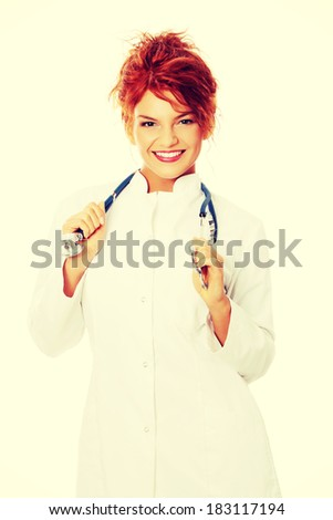 Smiling medical doctor or nurse. Isolated on white background - stock photo