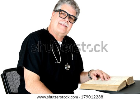Smiling medical doctor portrait reading a book - stock photo