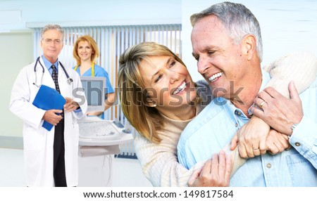 Smiling medical doctor with stethoscope and elderly couple. - stock photo
