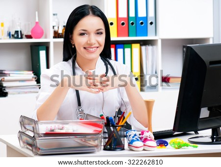Smiling medical doctor woman in the office  - stock photo