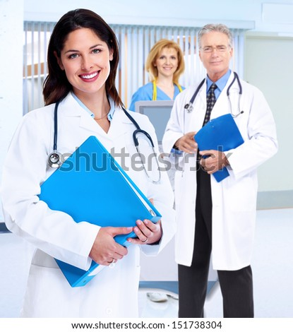 Smiling medical doctor woman with stethoscope. Health care. - stock photo