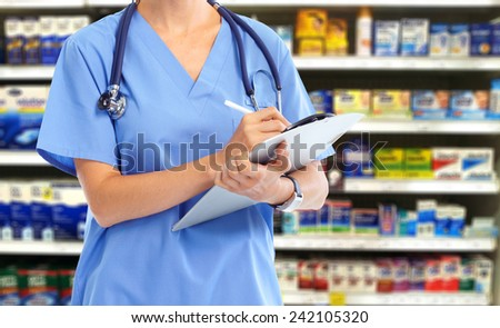 Smiling medical doctor woman with stethoscope over blue background - stock photo