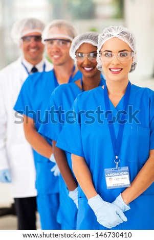 smiling medical researchers team in lab - stock photo