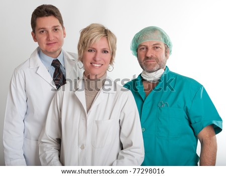 Smiling medical staff team with a surgeon a practitioner and a nurse