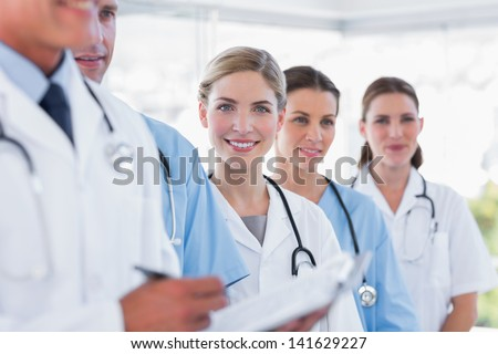 Smiling medical team in row in a hospital