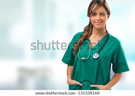 Smiling medical woman doctor with stethoscope - stock photo