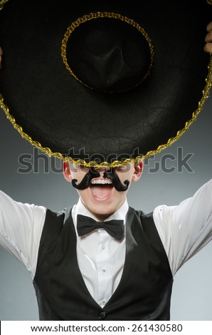 Smiling mexican with sombrero isolated on white - stock photo