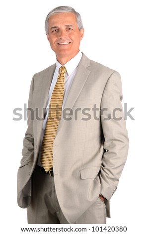 Smiling middle aged businessman with his hands in his pockets. Three quarters  over a white background. - stock photo