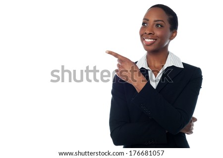 Smiling middle aged corporate lady pointing away