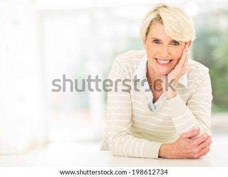 smiling middle aged woman relaxing  - stock photo