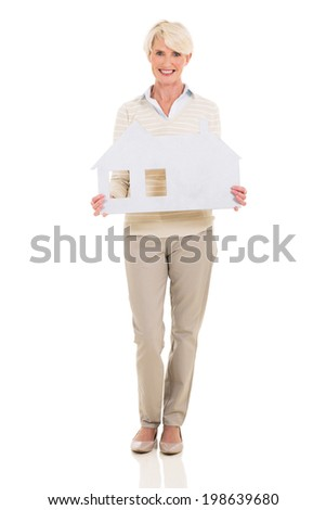 smiling middle aged woman showing house symbol on white background - stock photo