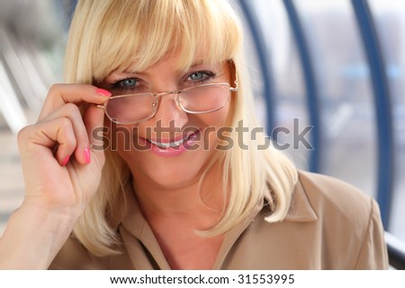 Smiling middleaged woman in glasses