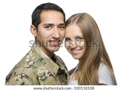 Smiling Military Couple Pose for a Portrait
